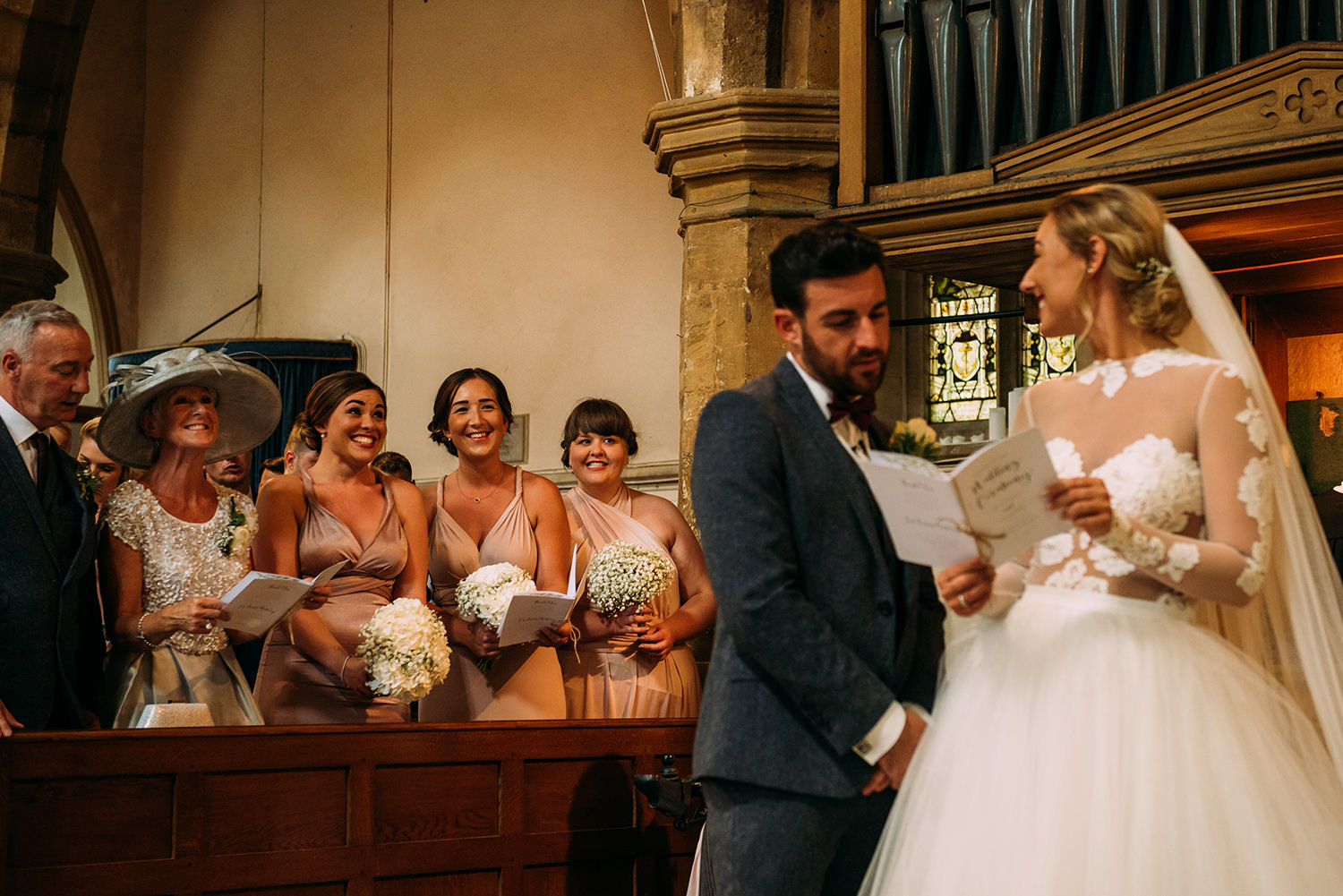 bride looks back at bridesmaid's and they all laugh