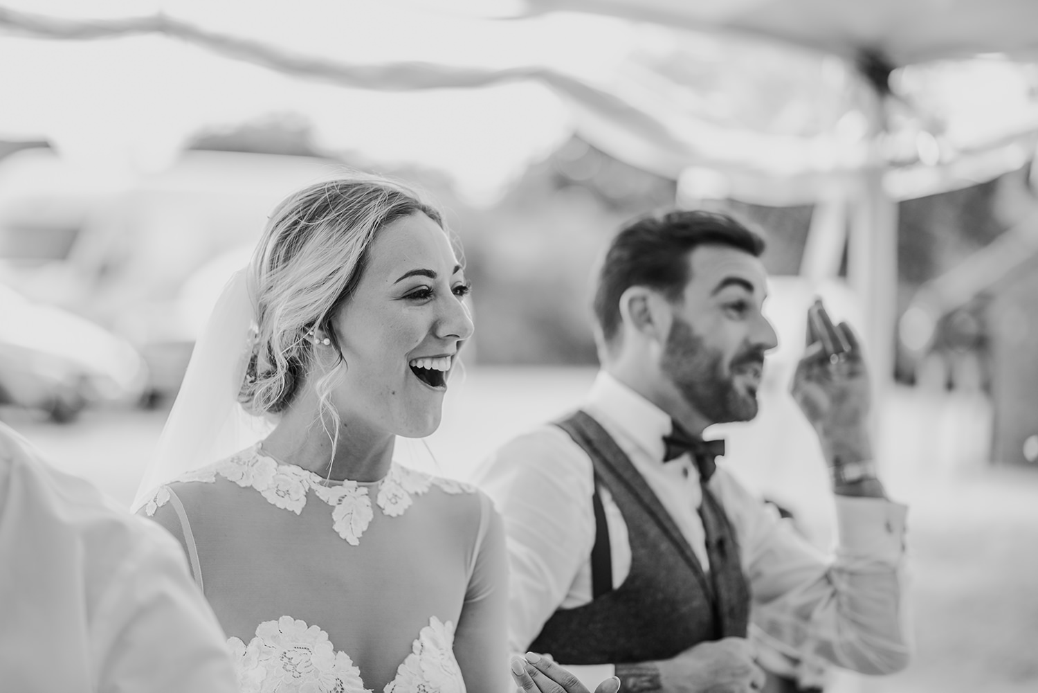 bw photo bride and groom laughing