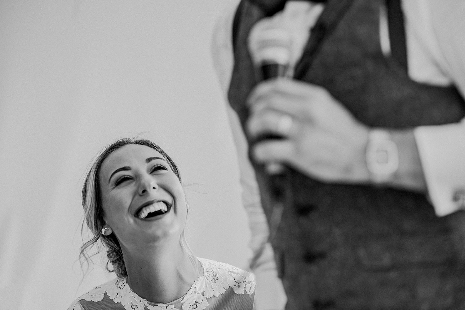 bw photo of the bride laughing at the groom