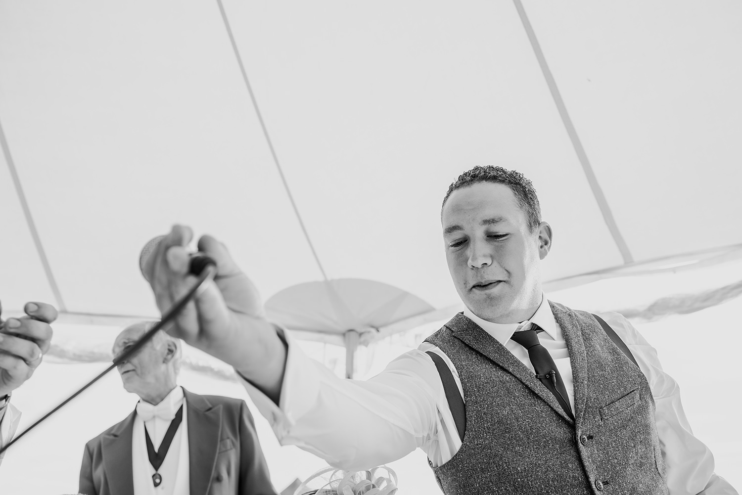 bw photo. Best man takes the microphone