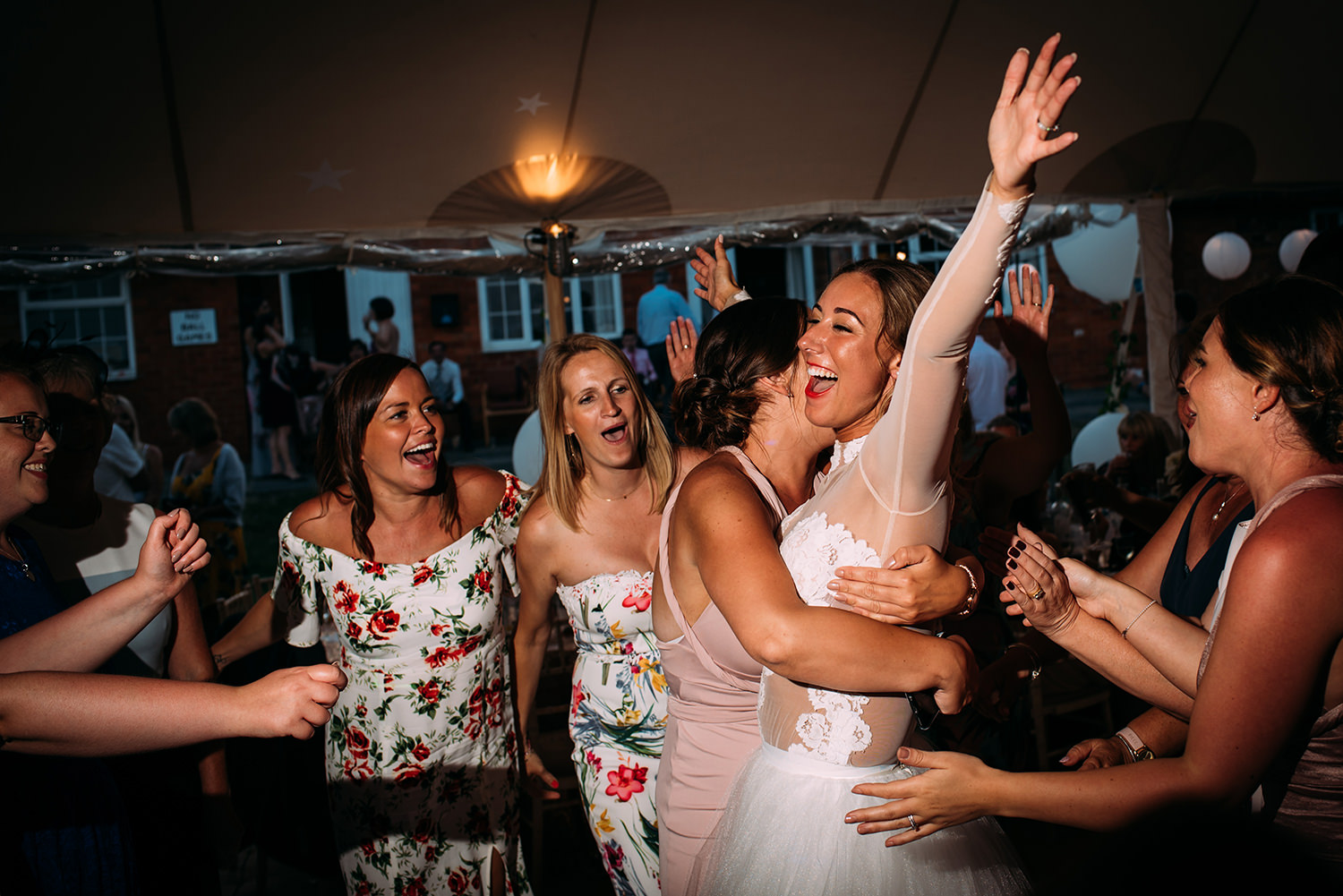 bride hugs her friends