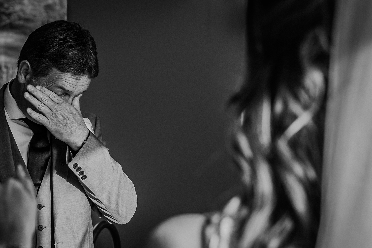 Bw photo. Dad wipes his eyes as he sees his stunning daughter