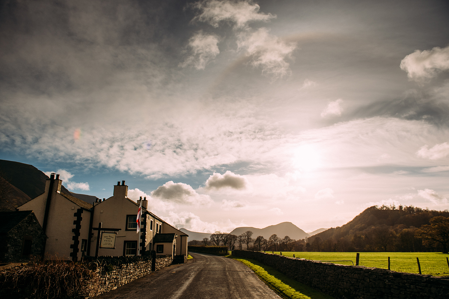 new house farm with moody clouds