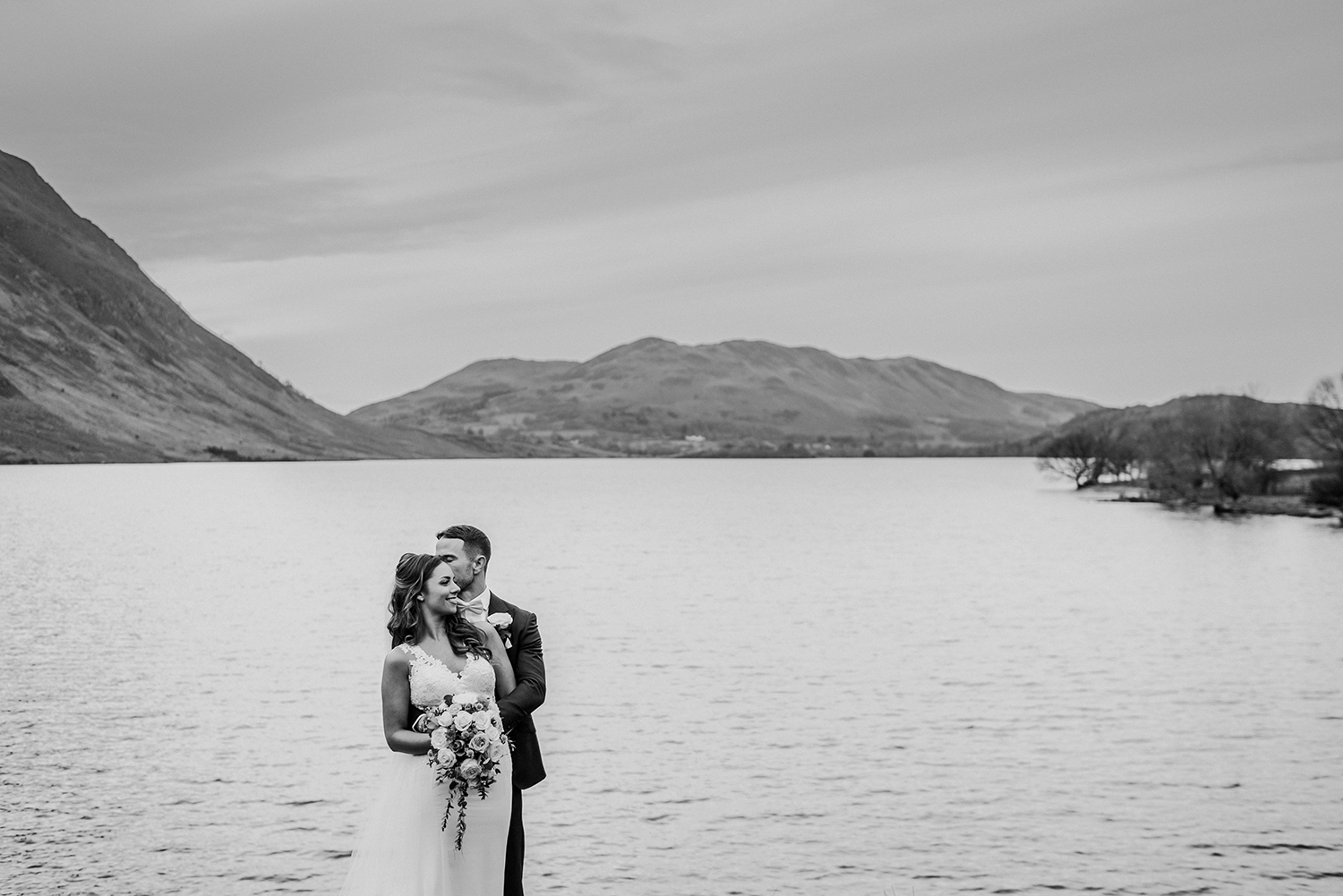 bw photo of the couple at the lake