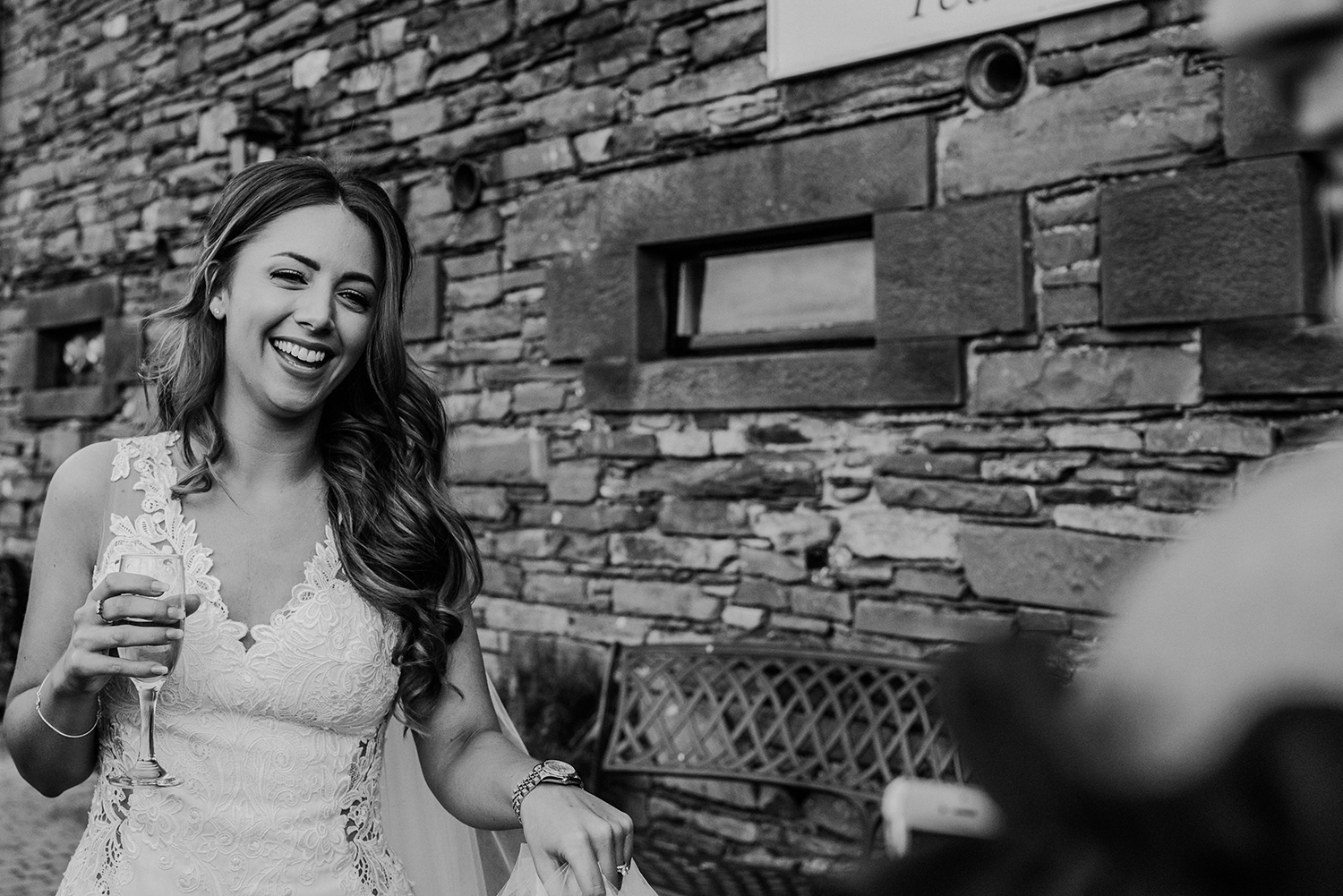 bw photo of the bride laughing