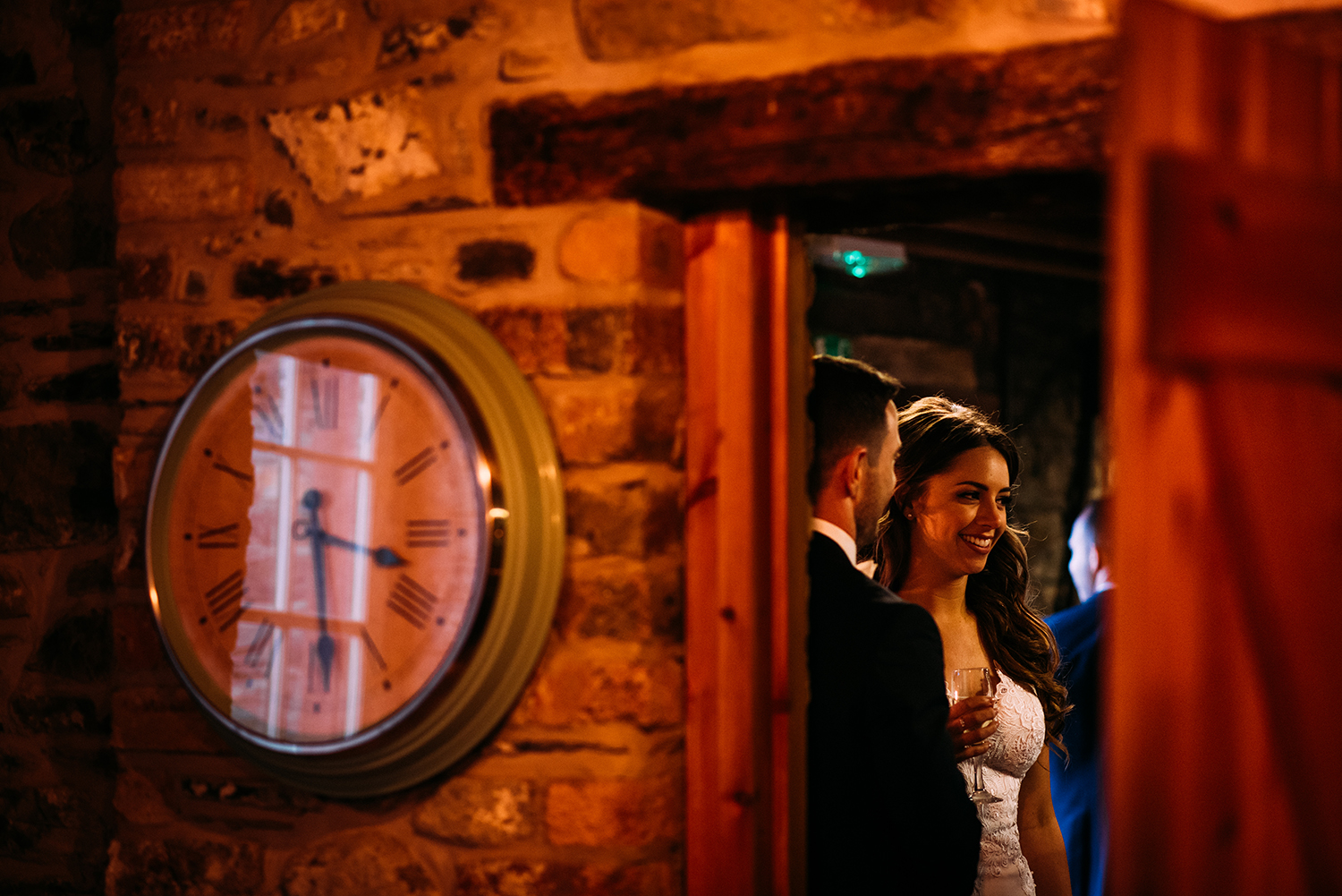 bride and groom chatting to guests