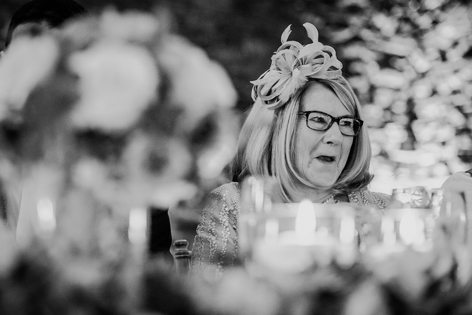bw photo, grooms mother does a shocked/naughty, laugh expression