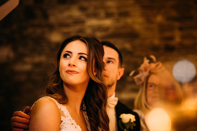 tear rolls down the brides cheek during the speeches