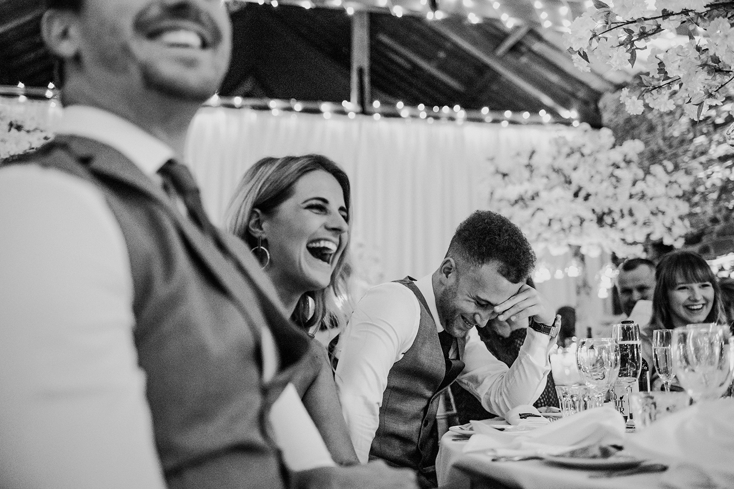 bw photo of guests laughing