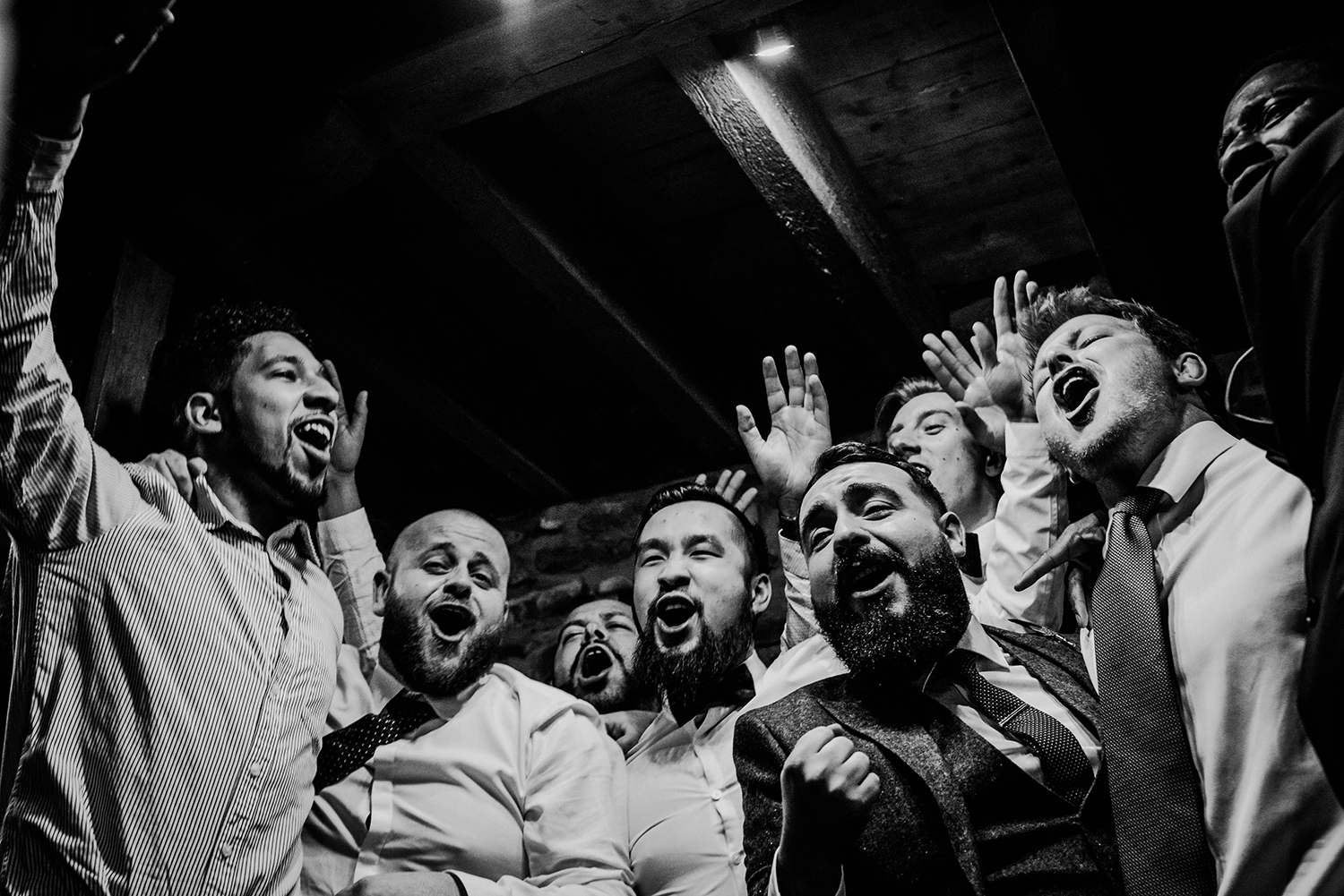 bw photo of guests singing