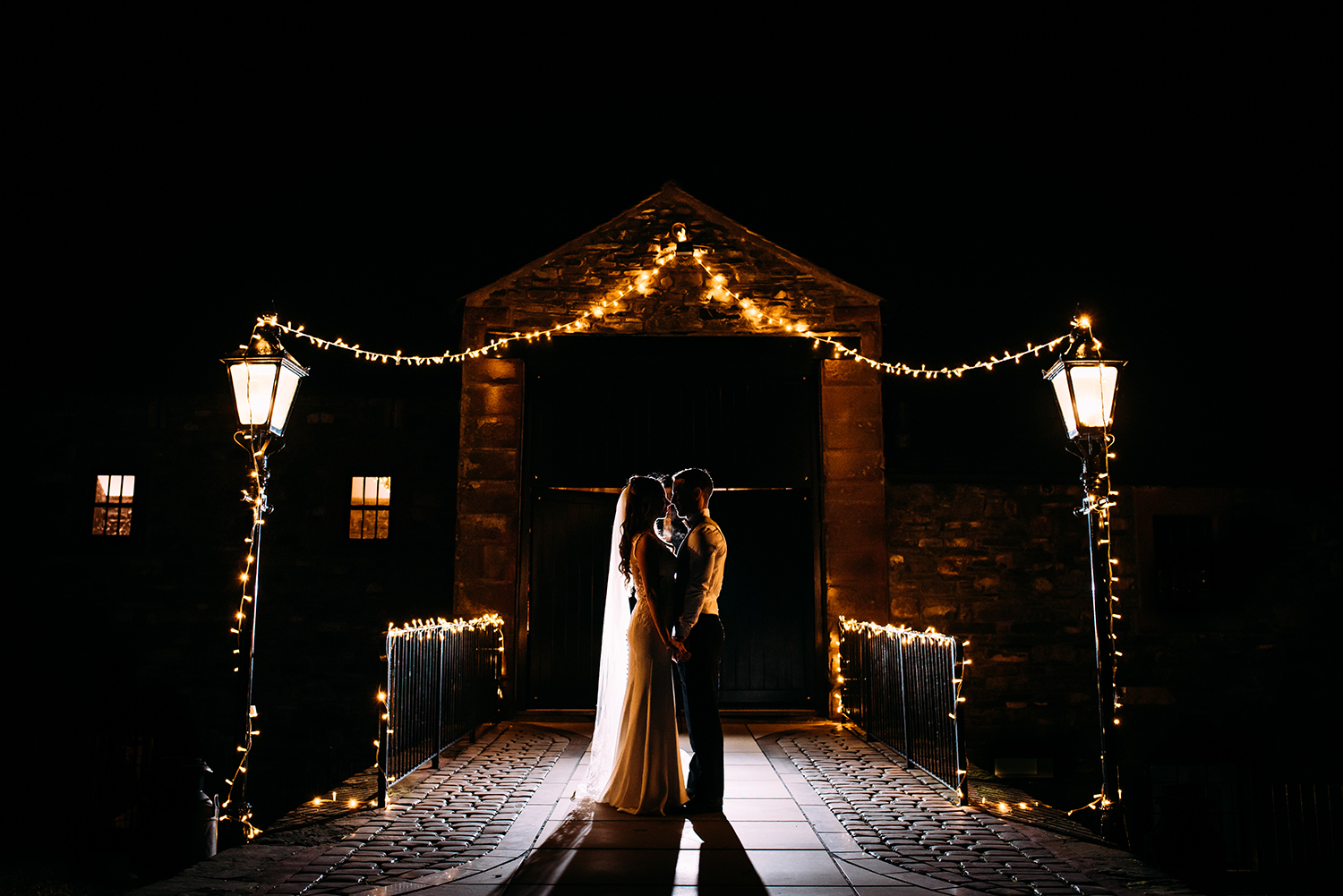 bride and groom outside the venue at night