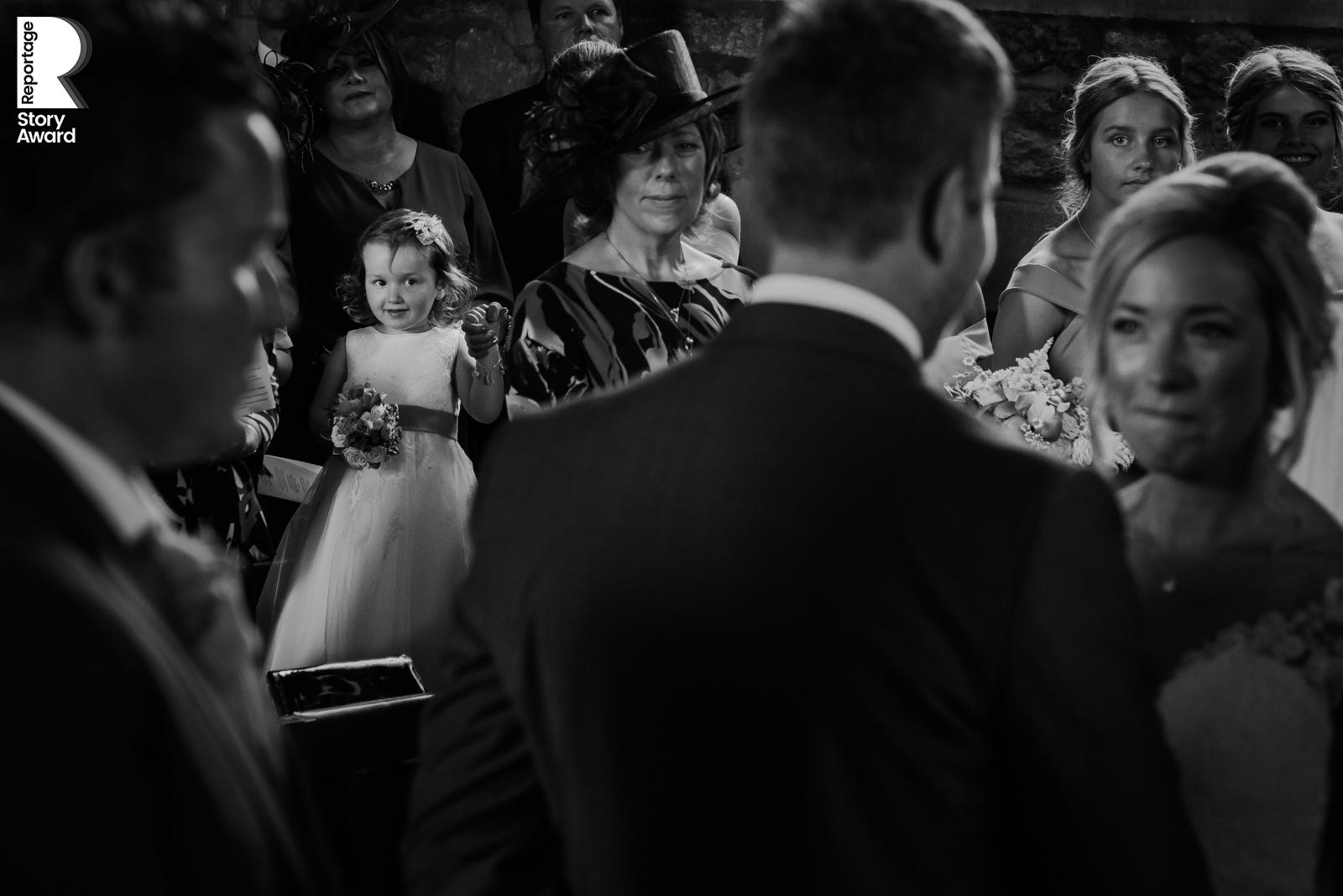 little girl watching the ceremony. Bw photo