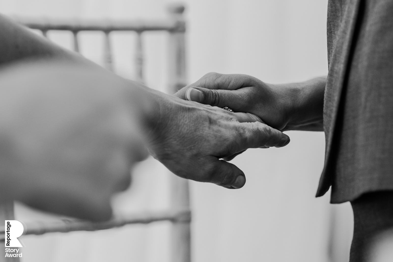 bw photo. Close up of hands holding during the speeches