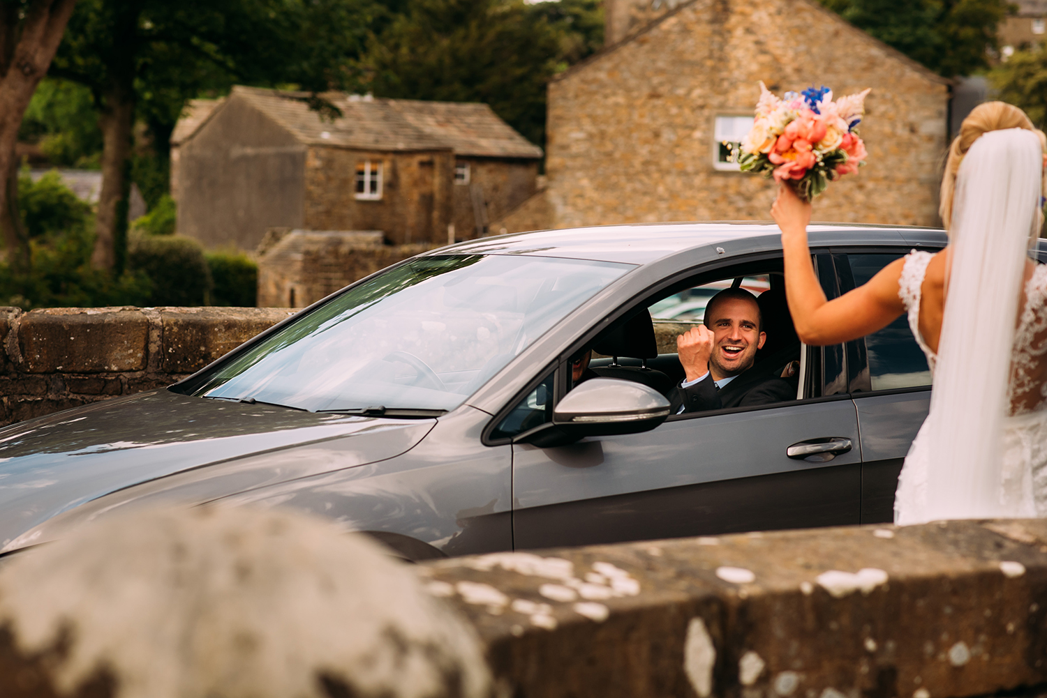 A passer by in the car beeps and cheers the couple