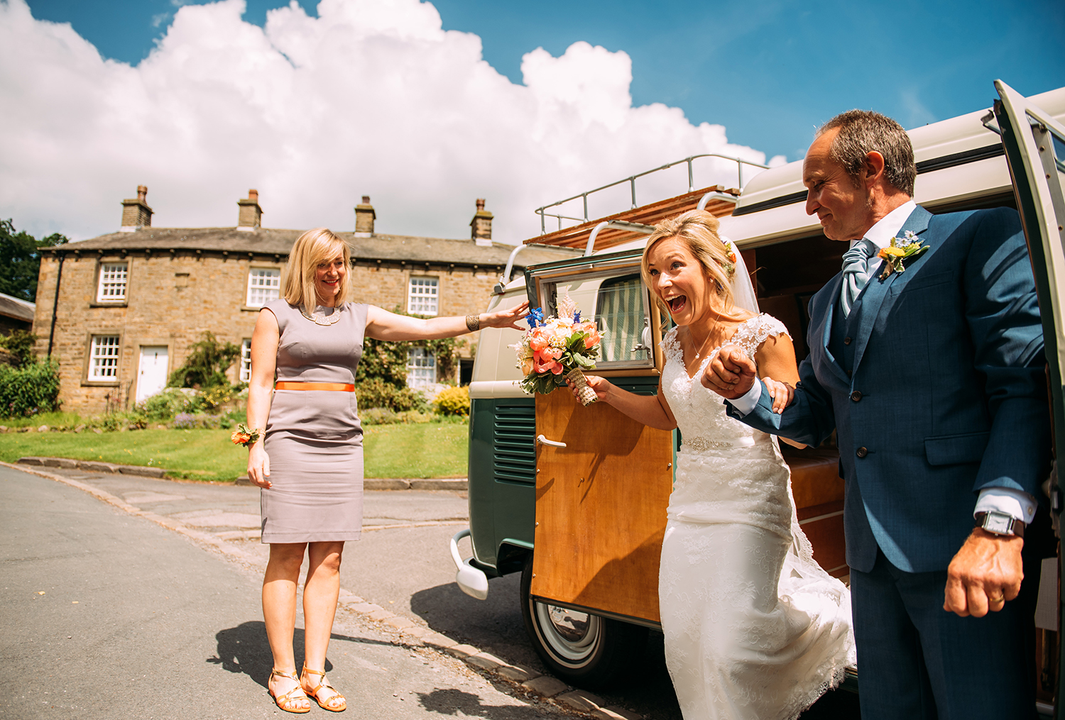 excited bride gets out of the camper helped by her father