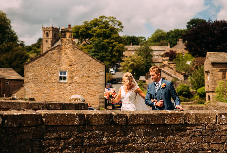 bride and groom stroll through Downham