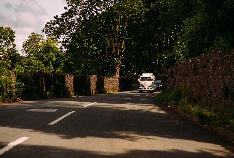 vintage camper van driving down the road