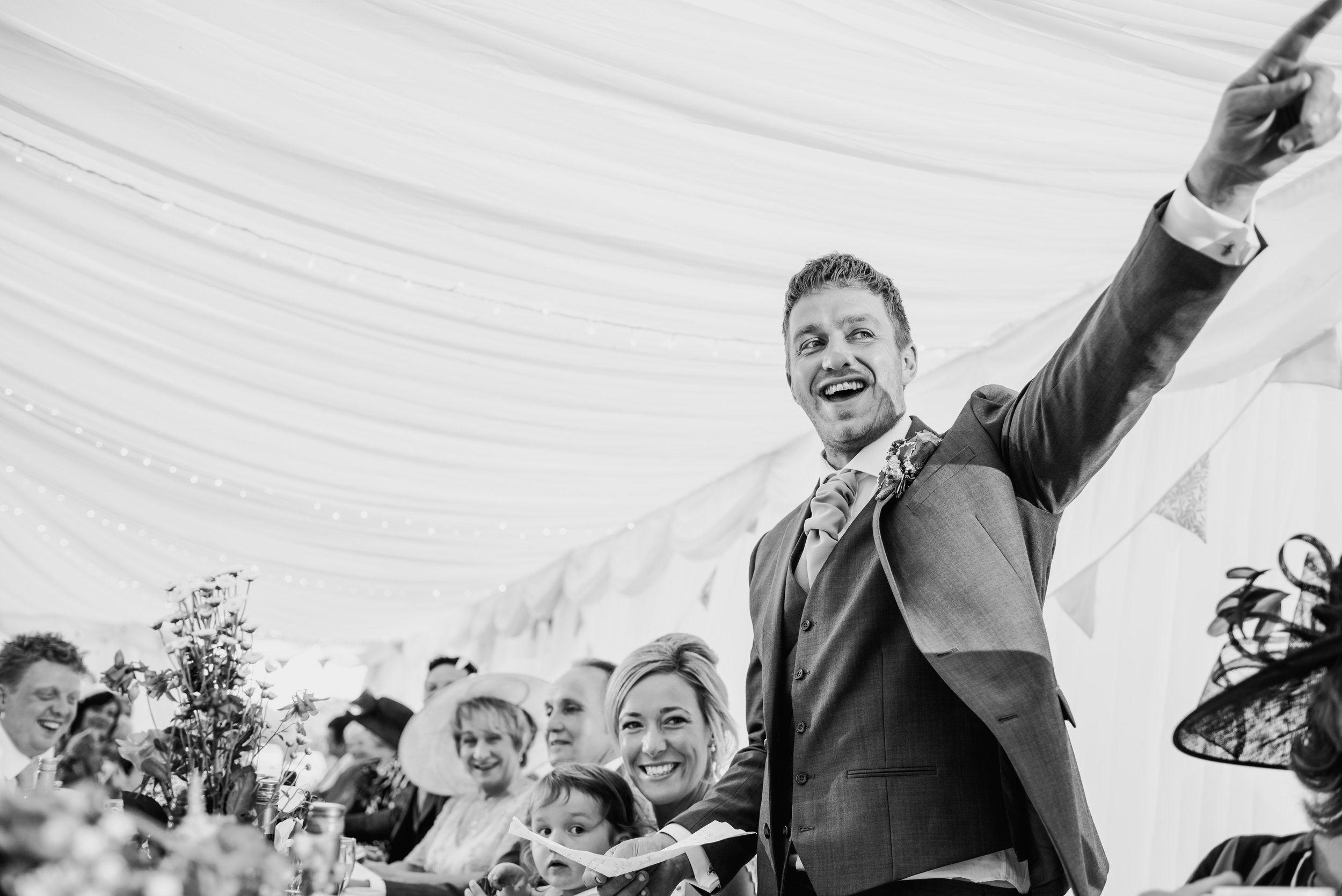 bw photo of the groom pointing