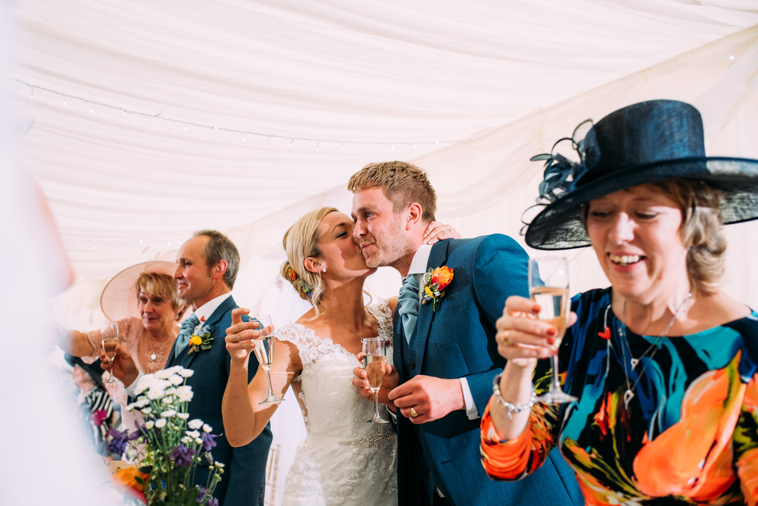 bride kisses groom after his speech