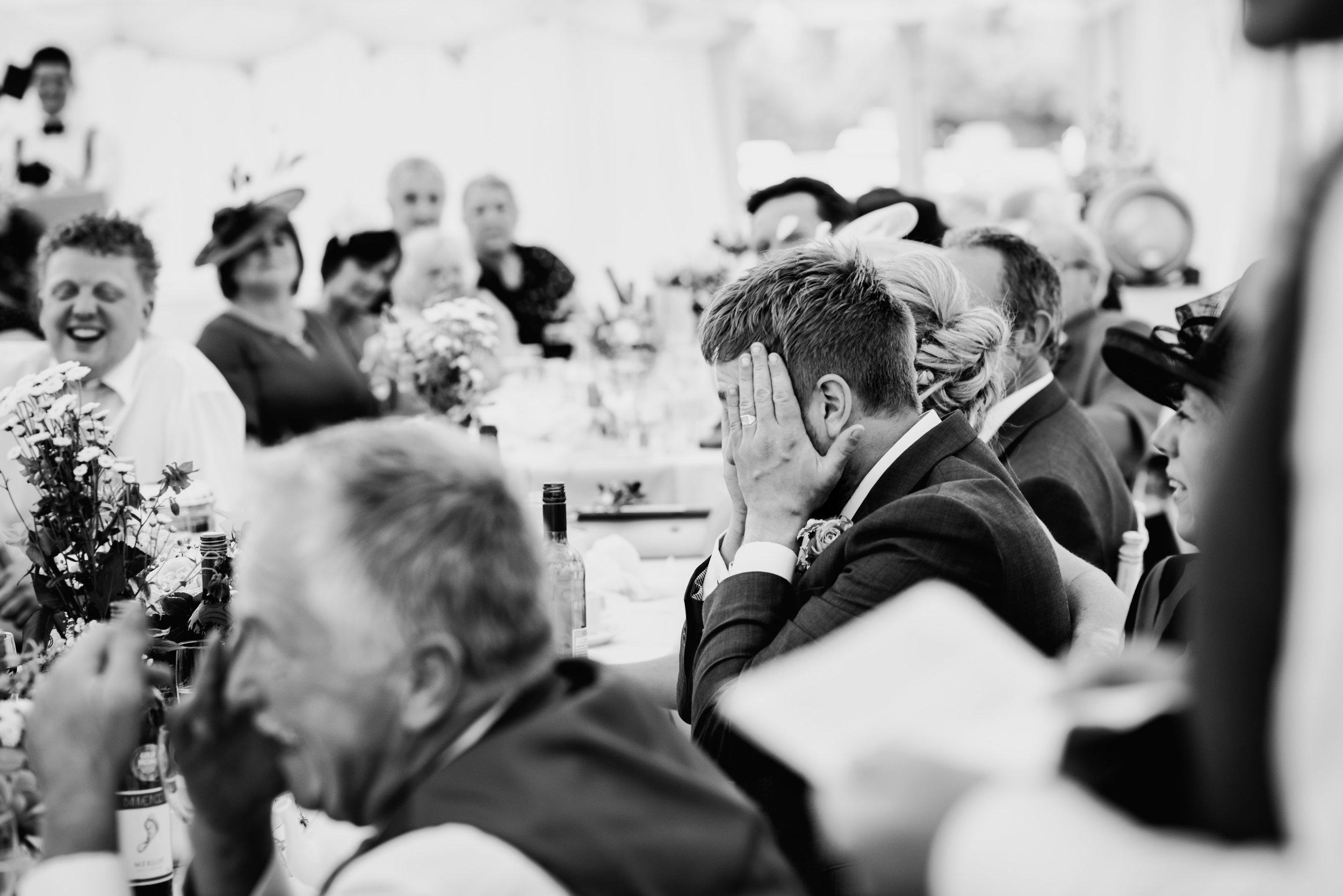 bw photo - embarrassed groom