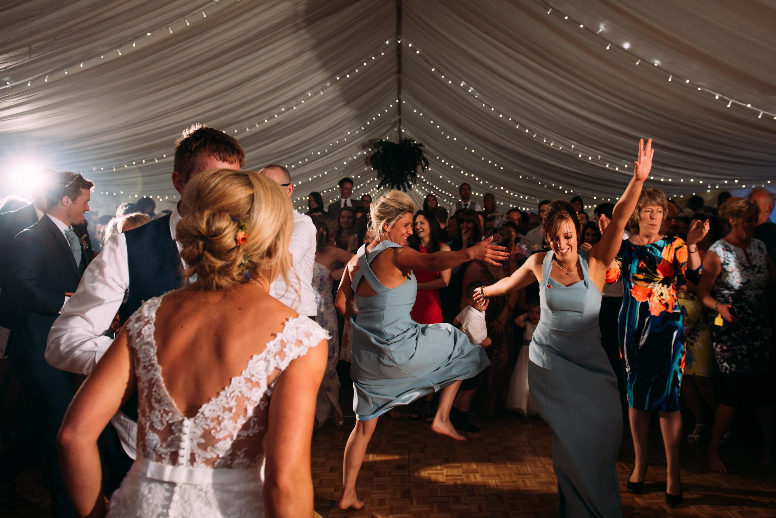 bridesmaids join the dance floor