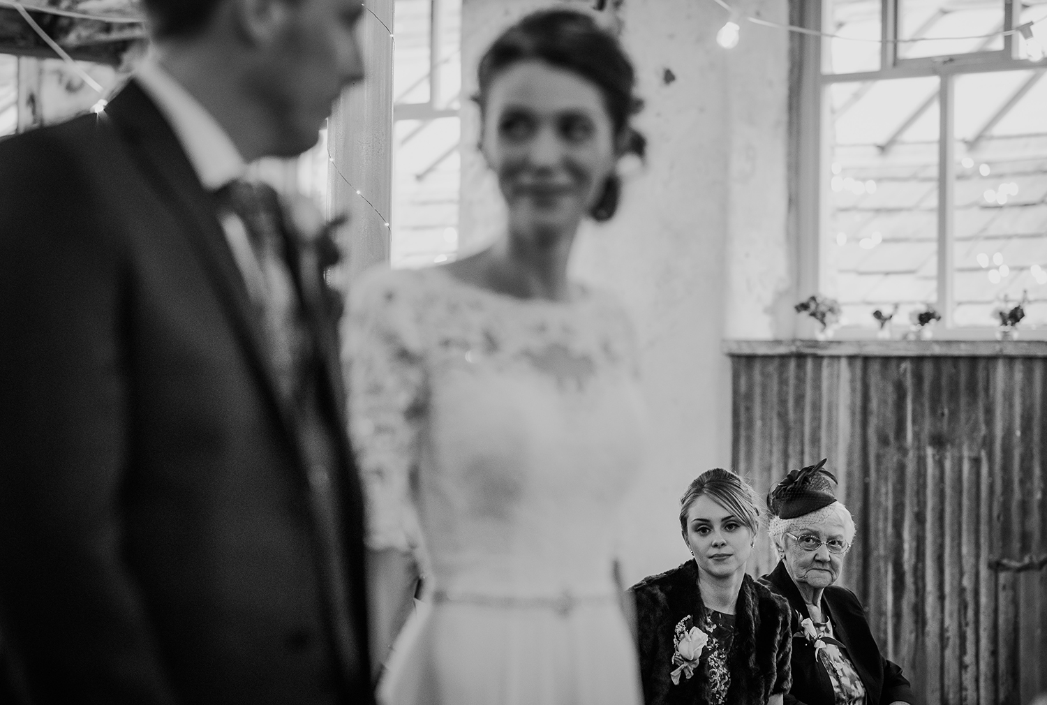 BW photo. Brides grandmother looking on at the couple