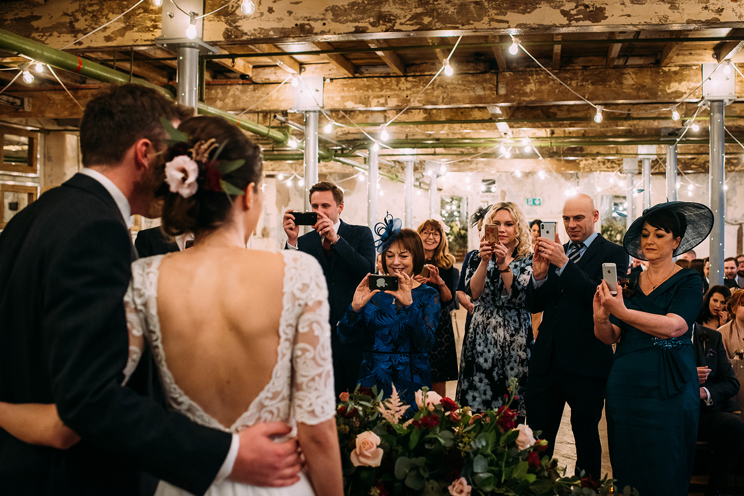 guests photographing the couple