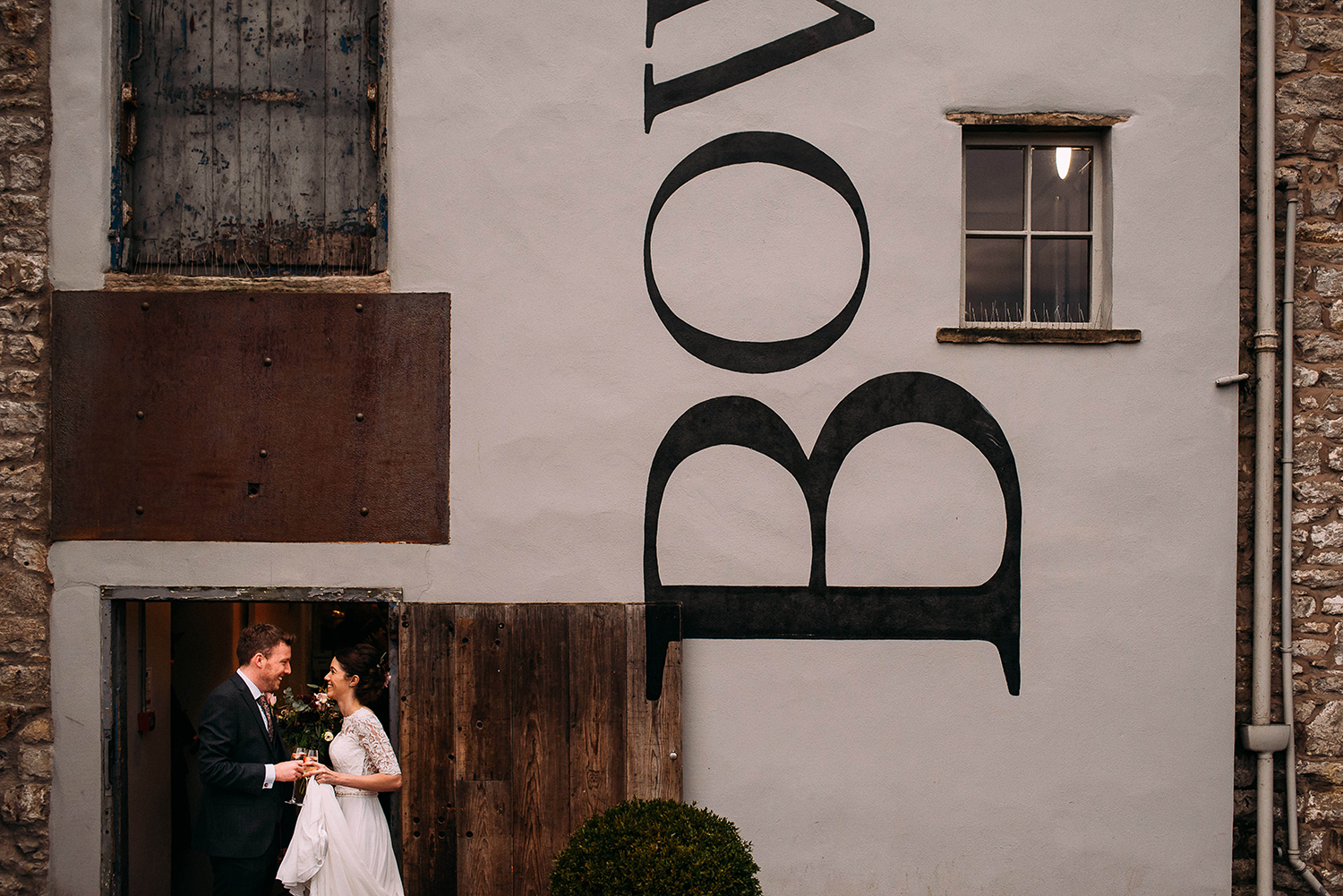 bride and groom at the front of the mill
