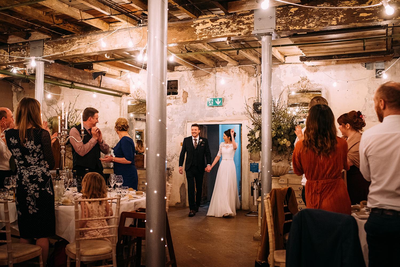 bride and groom enter the wedding breakfast