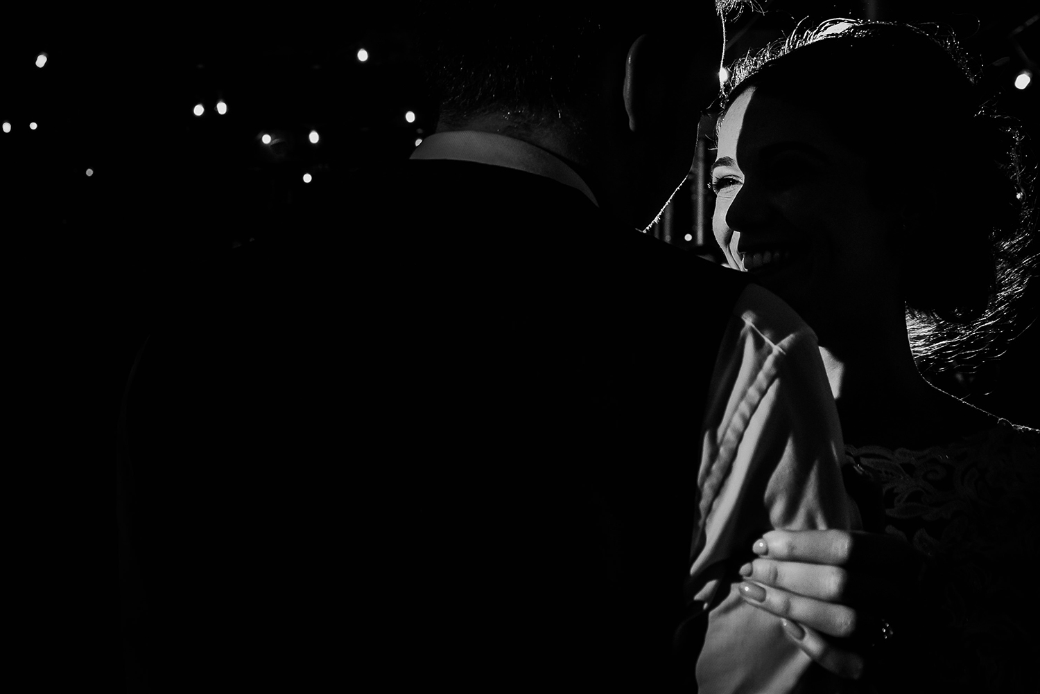 bw photo. The light just hitting one of the brides eyes during the first dance