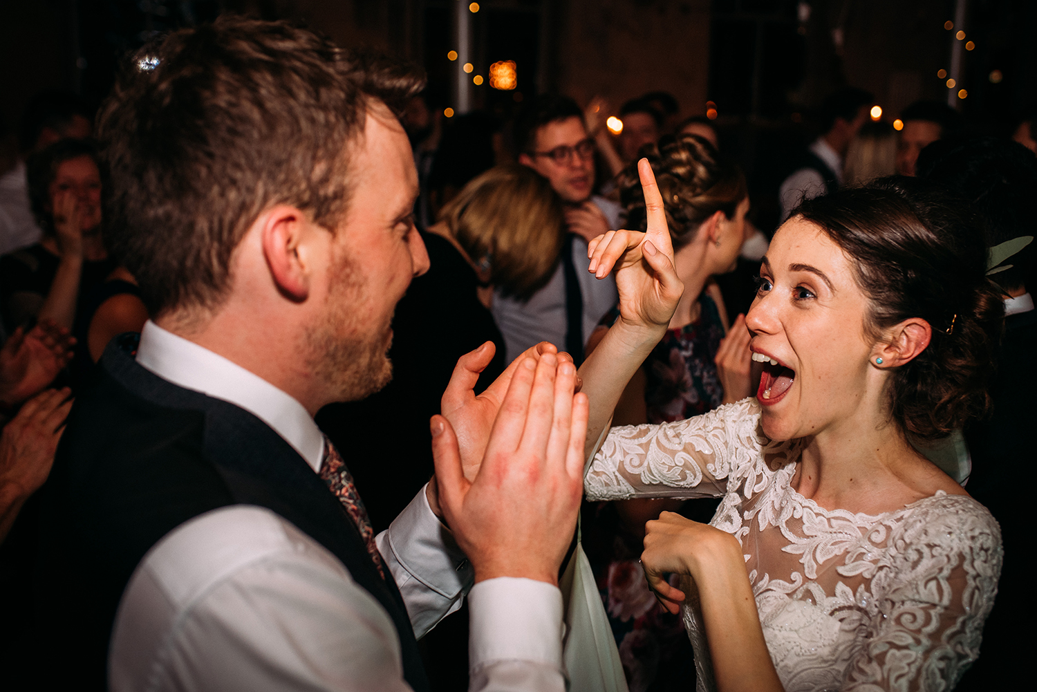 bride and groom dancing among the guests