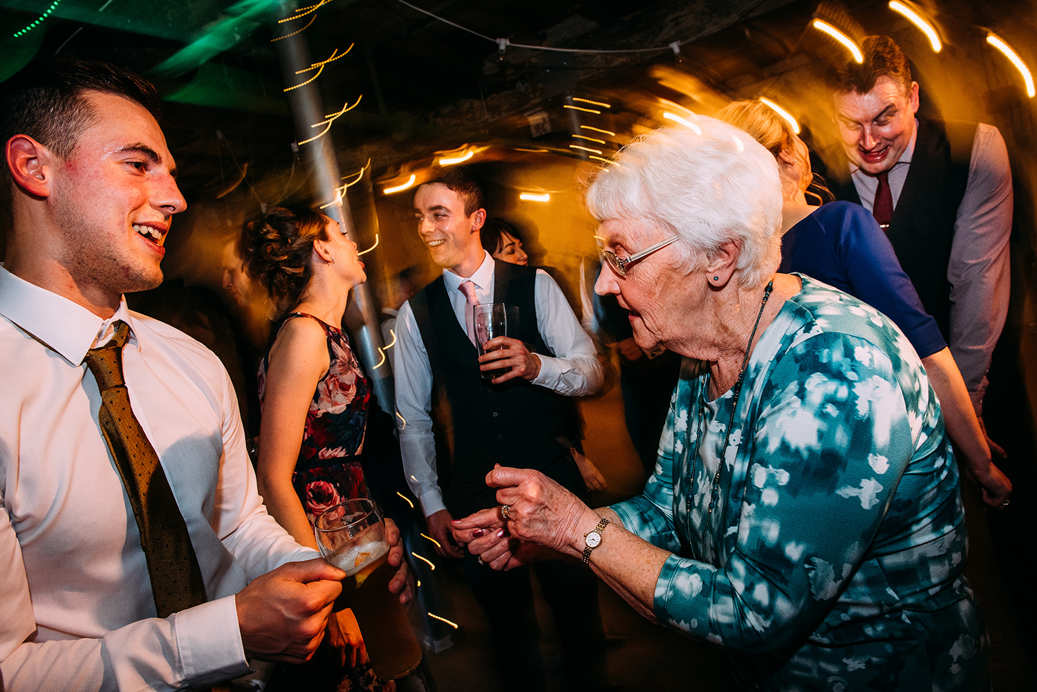 bride grand mother dancing with guests