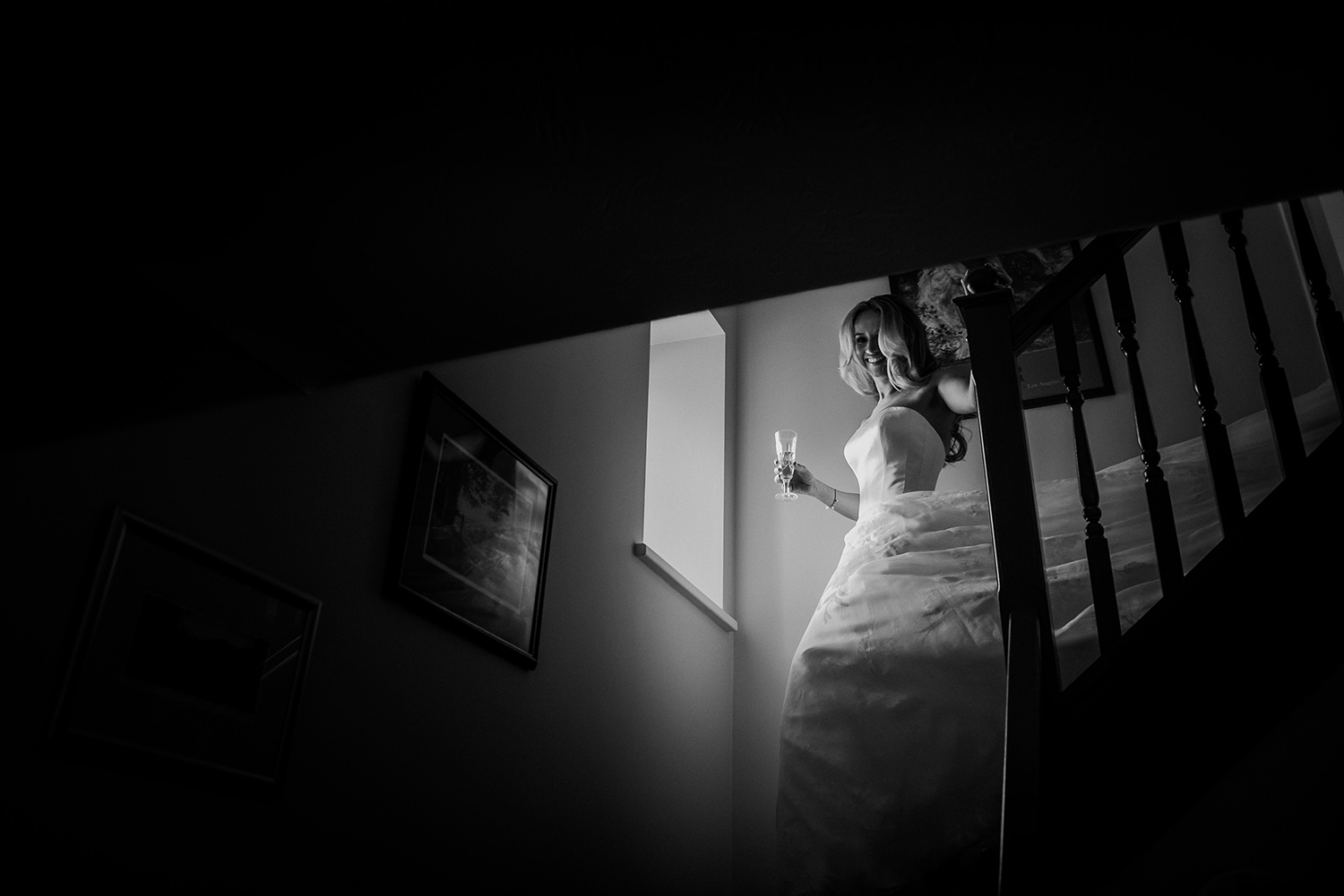 BW photo of bride coming down the stairs