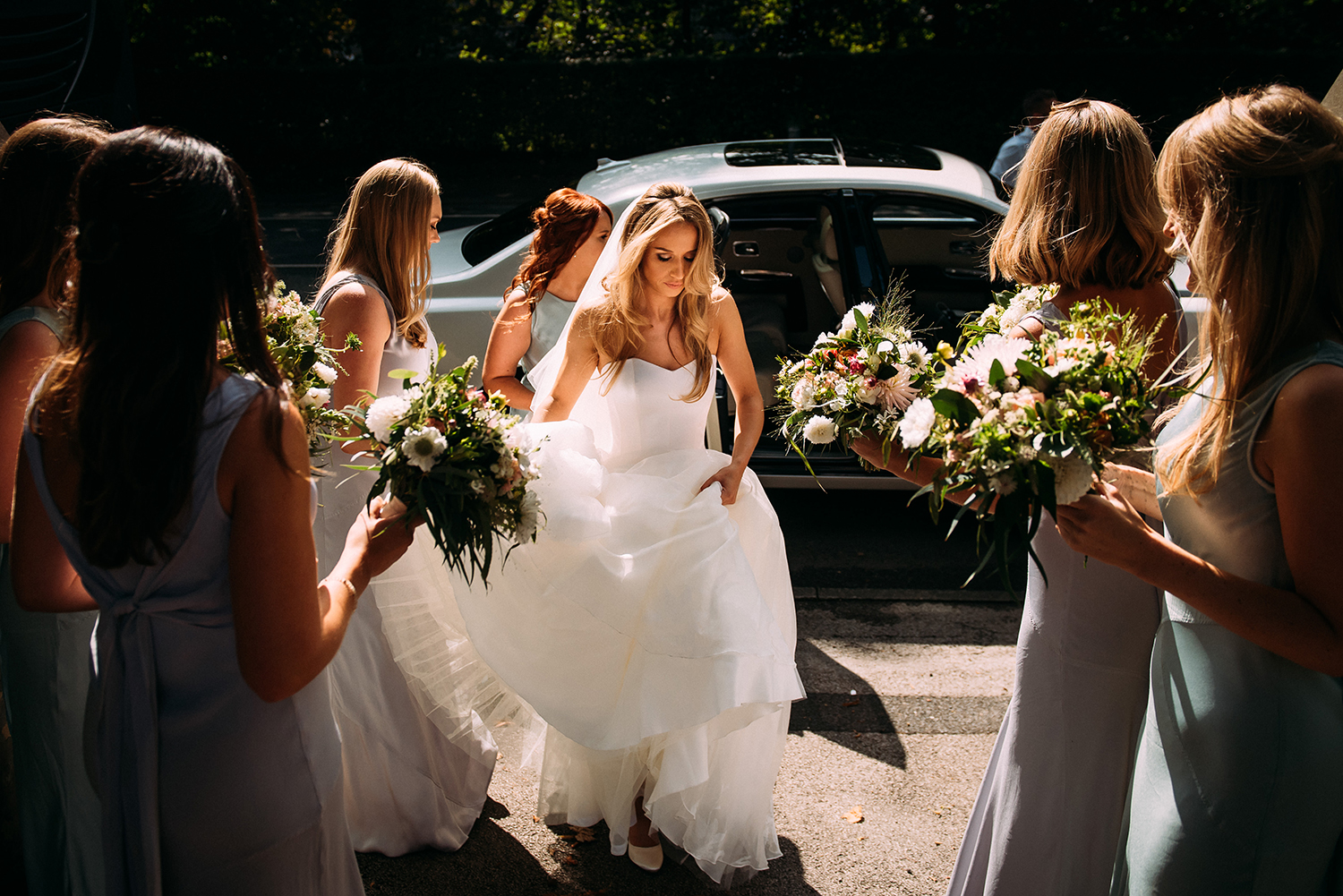 bride and bridesmaids approaching church