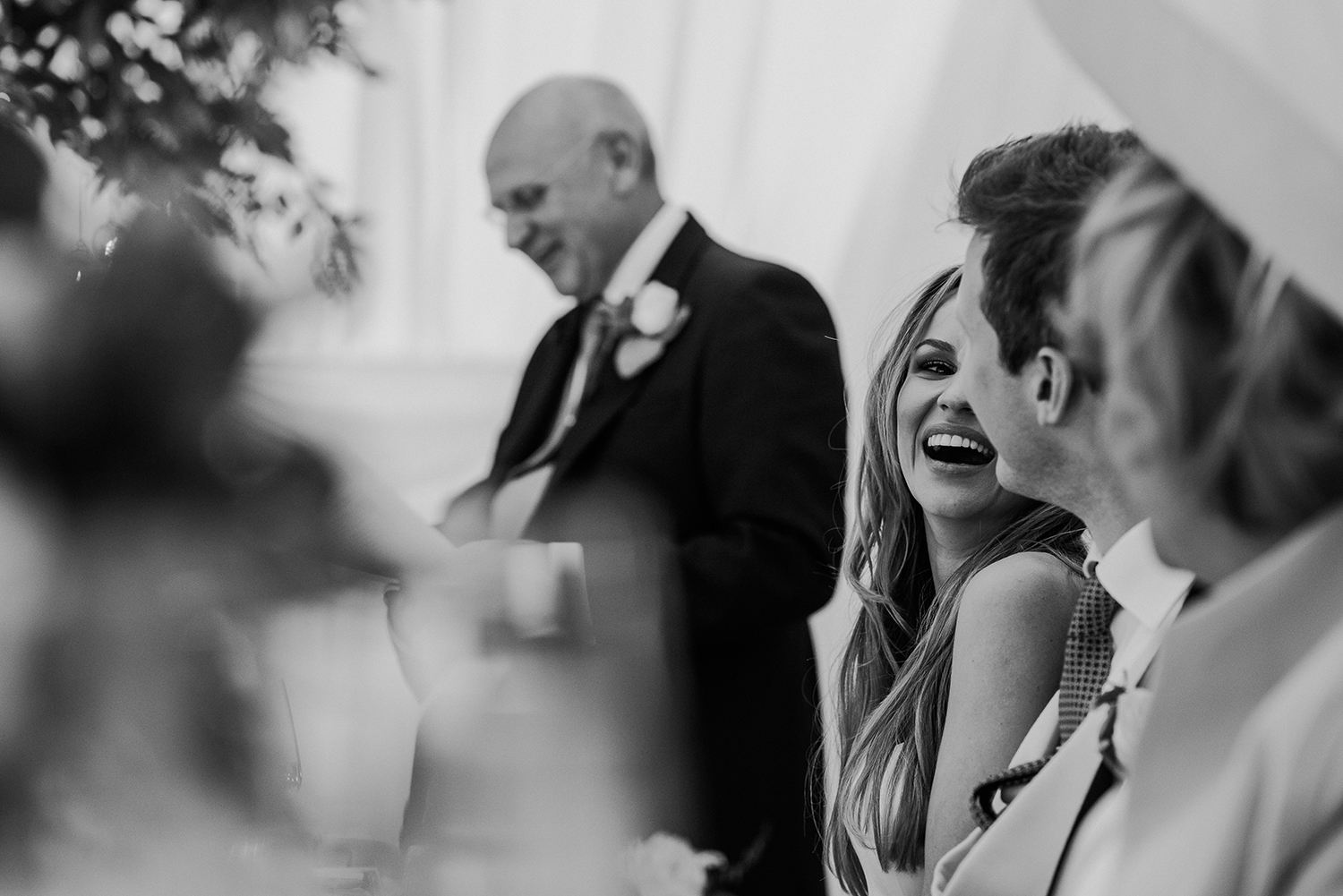 BW photo of bride laughing at the groom