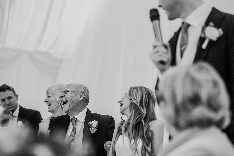 BW photo during grooms speech