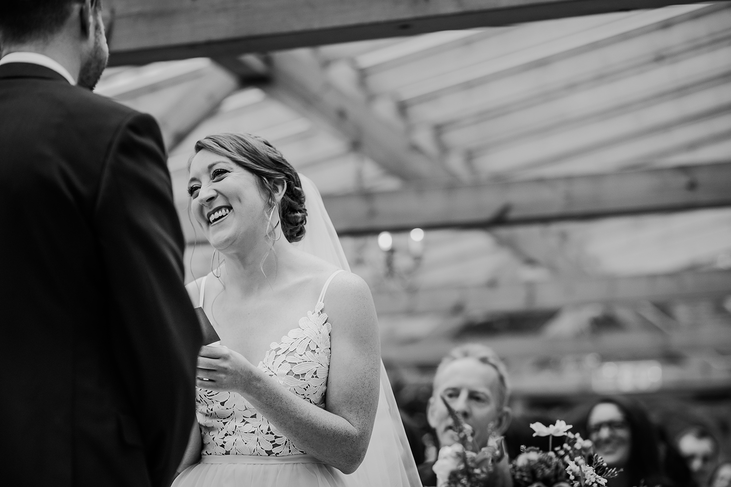 BW photo of the bride smiling at the groom