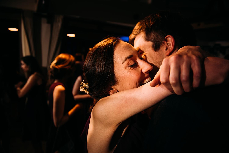 guests hug on the dancefloor
