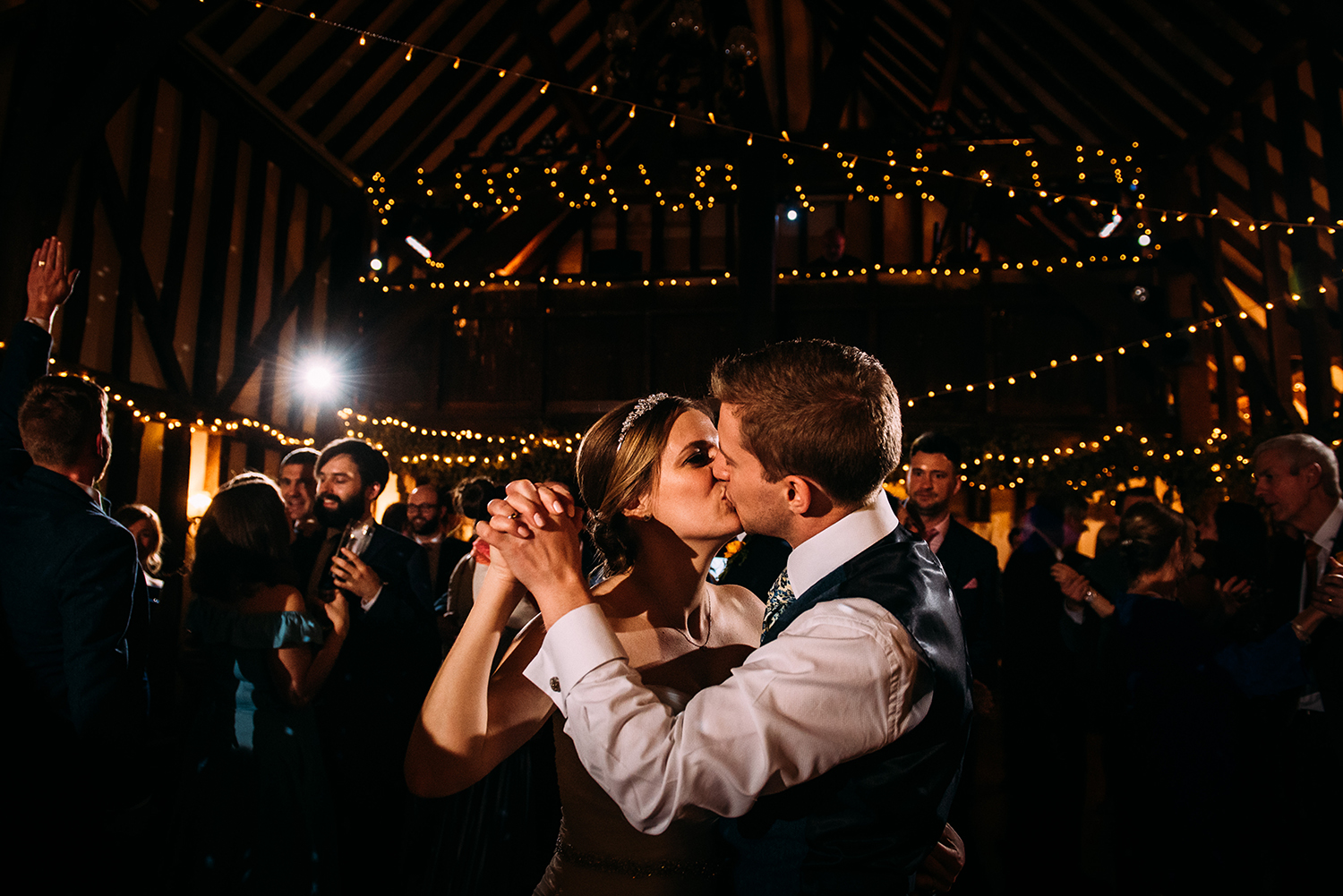 bride and groom kiss during the first dance