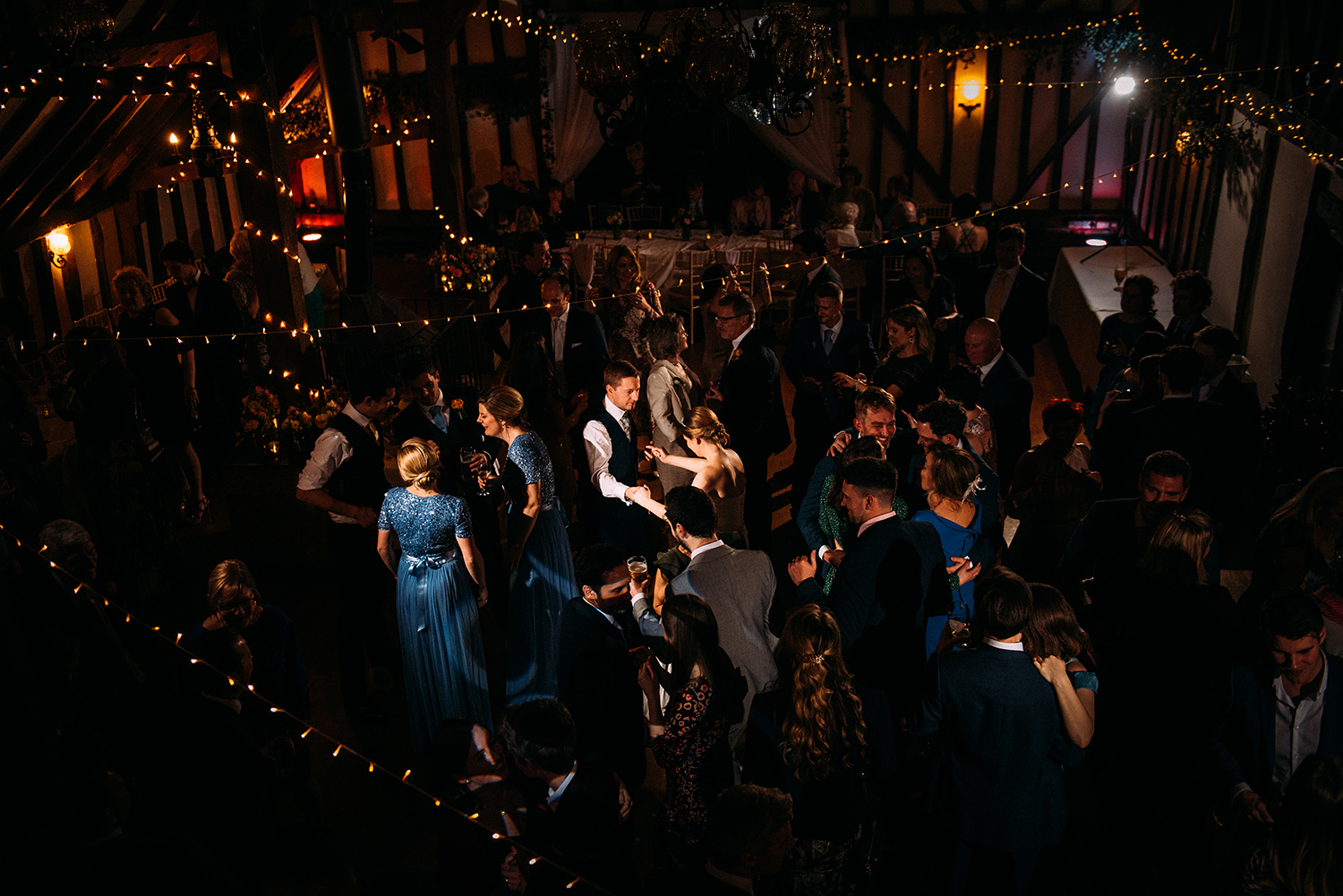 aerial shot of the full dance floor taken from the balcony with focus on the bride and groom