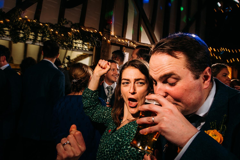 best man drinking a pint