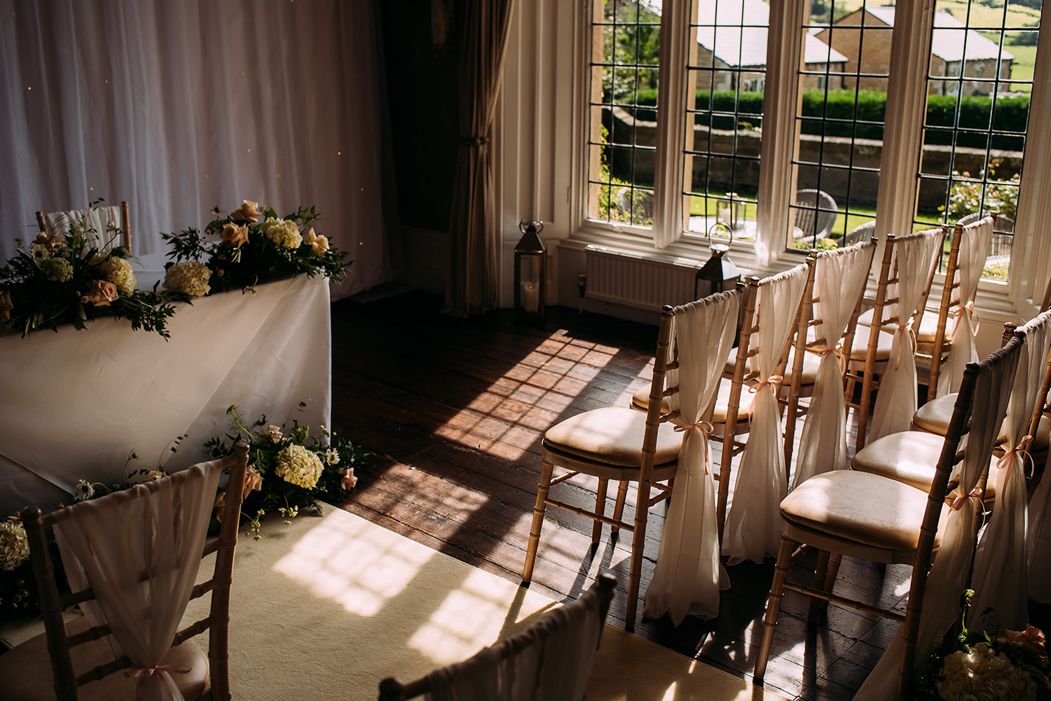light coming in through the ceremony room and shining on the chairs
