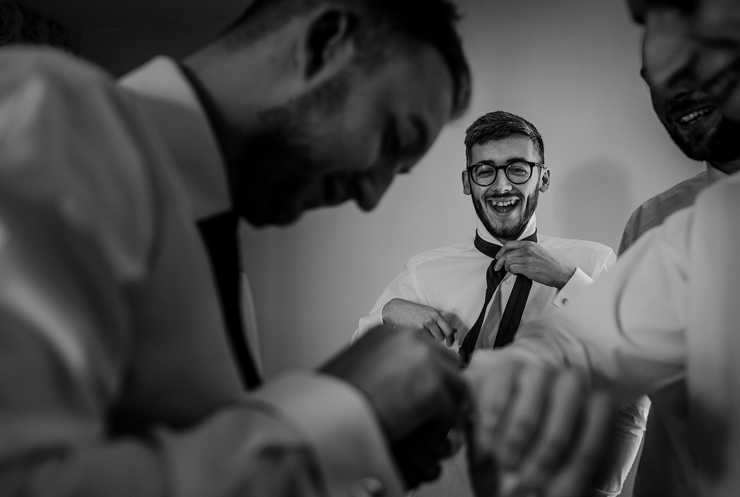 bw photo of the groomsmen getting ready