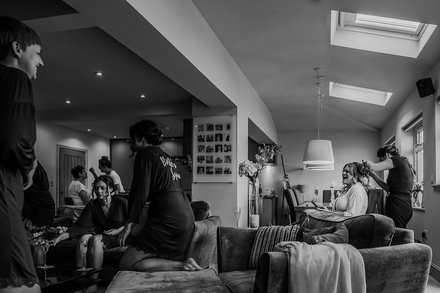 bw photo of the bride laughing with friends and family at home in the morning