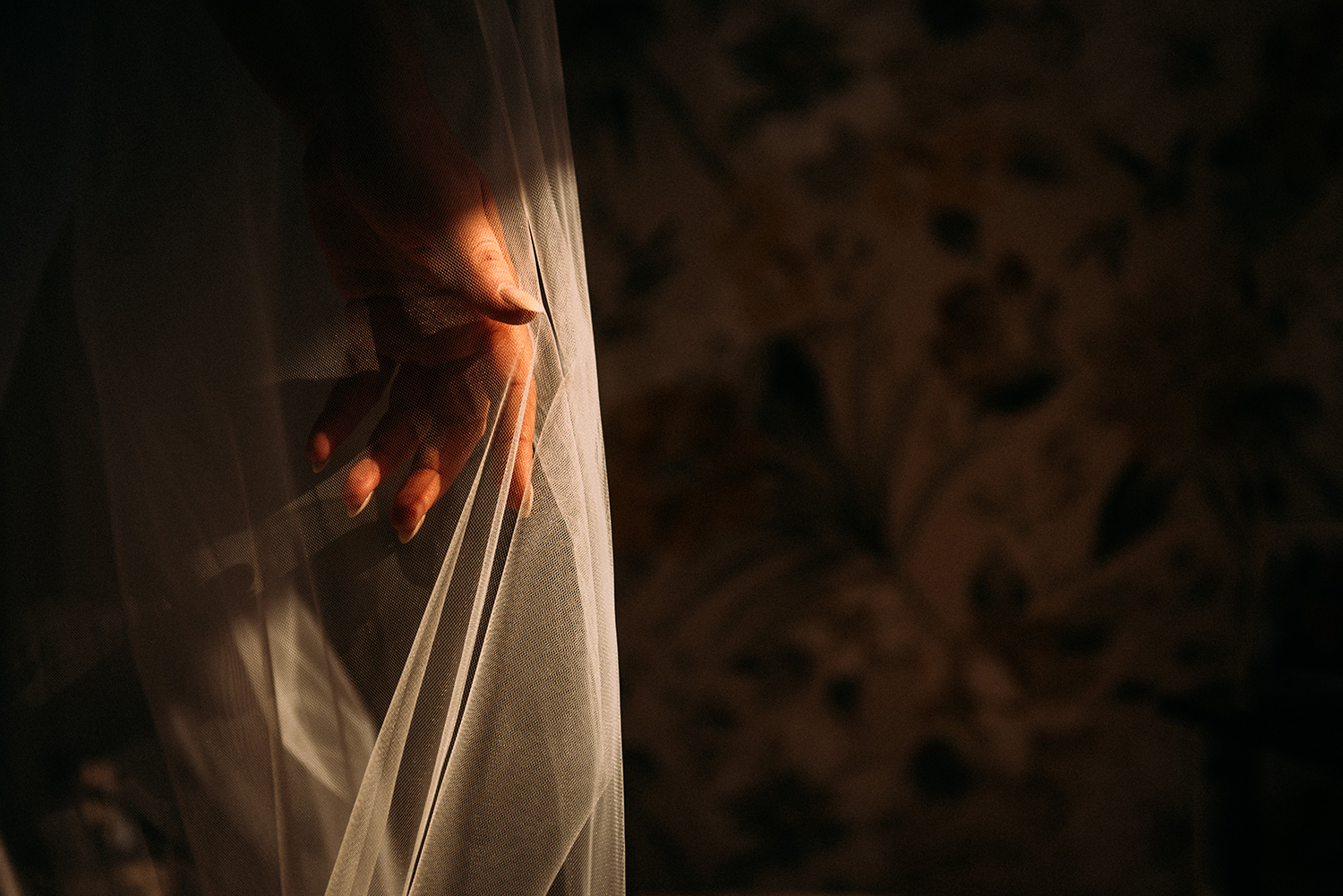 brides hand under the veil in nice sunlight