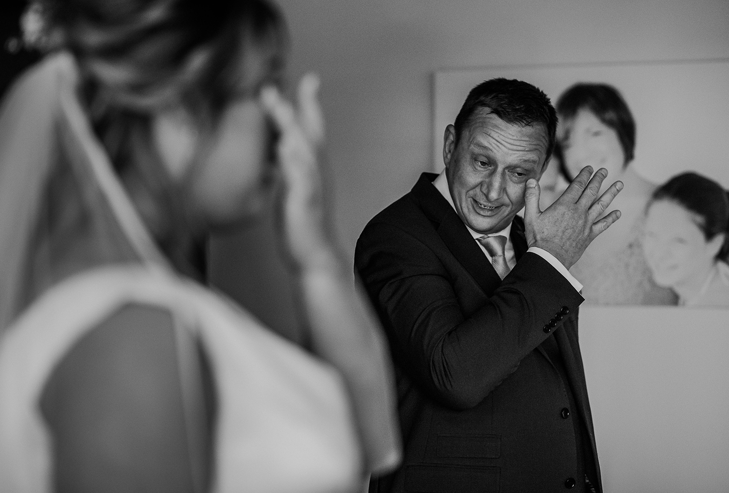 bride and her father wiping tears. BW photo