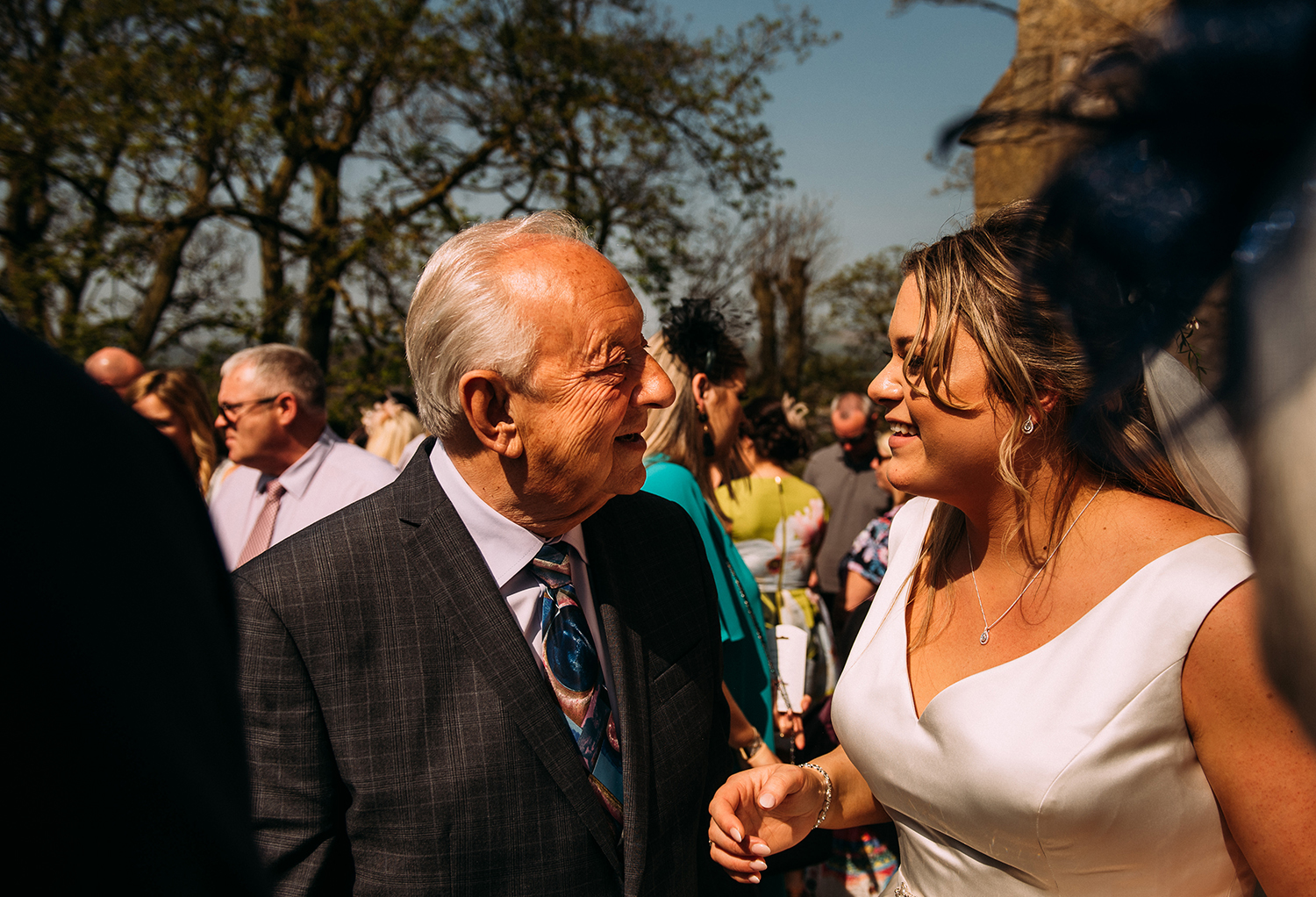 bride and her grandfather outside church