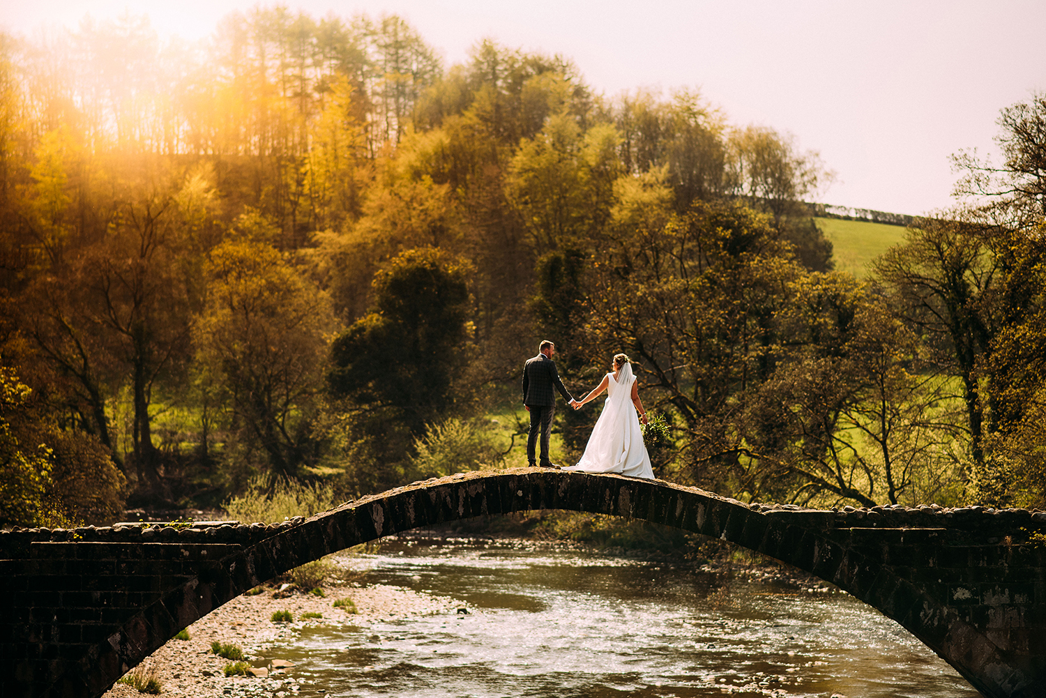 bride and groom on Cromwell bridge