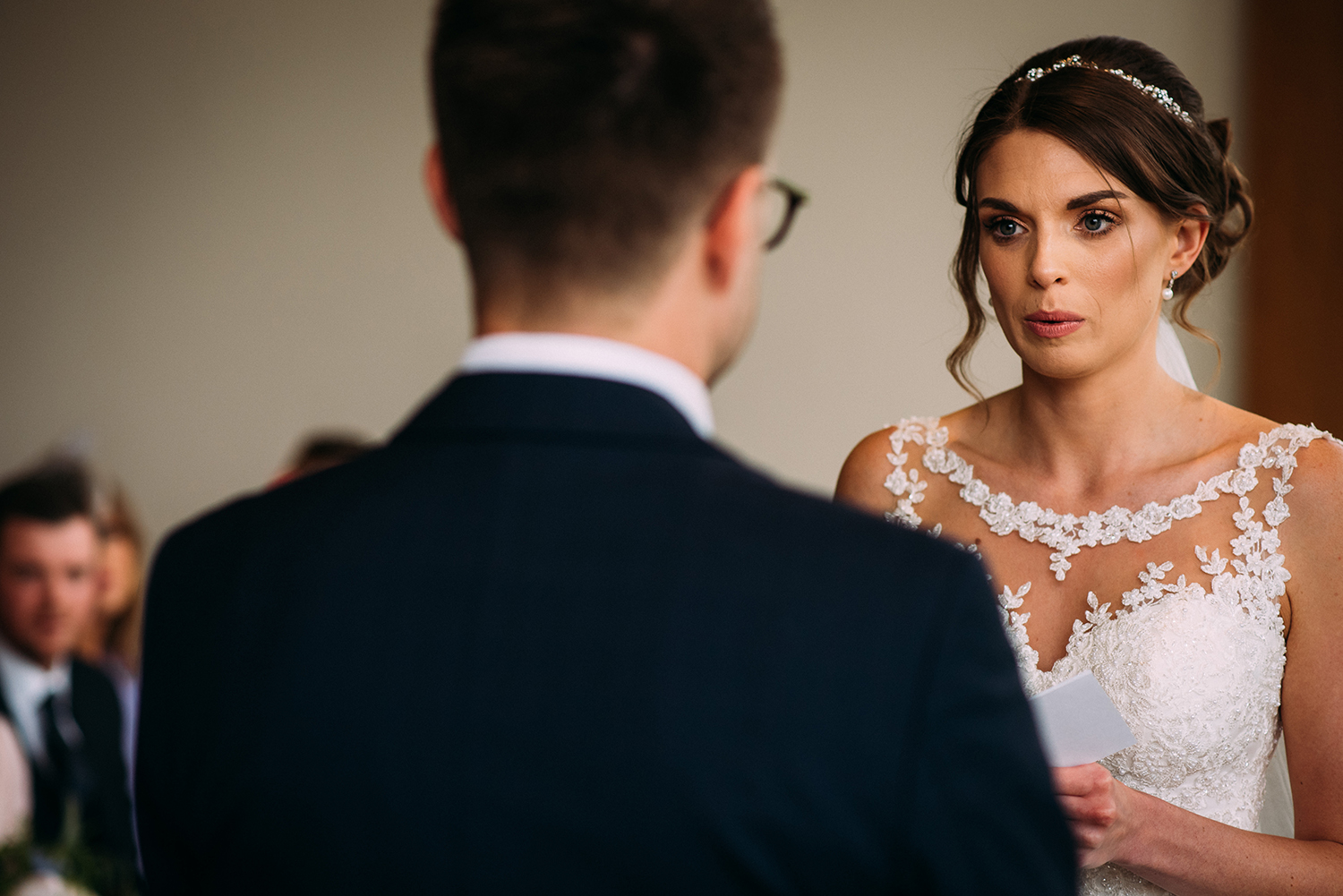 nervous bride takes a breath during the vows