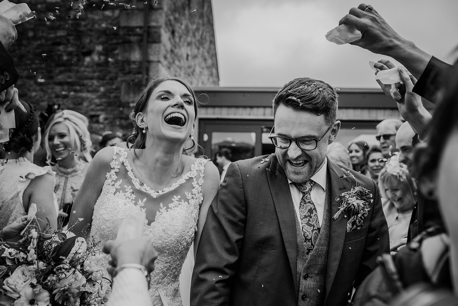confetti on the bride and groom at the Out barn. BW photo